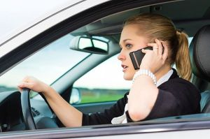 Female driver using a cell phone