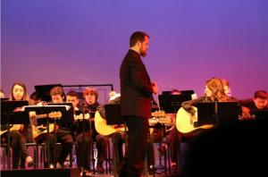 Winter Concert director Jesse Randell guides his musicians. Photo by Stanley So