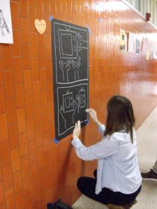 Down the hall in the main building, another artist created a chalk draw.