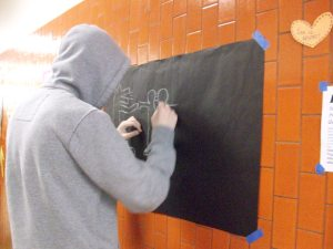 Another multimedia art student at work on the Haring-inspired designs.
