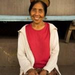 AlanStockPhotography-Bali-market-portrait-woman-smiling-sitting-traditional-hat-01