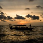 Silhouette sunset sea Cambodia passenger boat ferries locals to beach at Otrez Sihanoukville