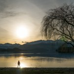 Silhouette watching sunset Wanaka New Zealand