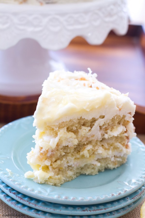 coconut cake is filled lemon curd and topped with a lemon cream cheese ...