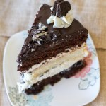 Layers of chocolate and vanilla cake are filled with vanilla frosting, crushed Oreos, and topped with a chocolate ganache.   www.alattefood.com