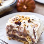This layered pudding dessert begins with a graham cracker crust, then has layers of JELL-O Instant Pudding, homemade whipped cream, and BAKER'S Semi-Sweet Chocolate shavings! This dessert is absolutely luscious.