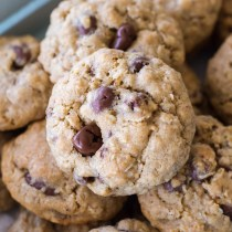 These homemade oatmeal cookies combine both raisins and chocolate to make them a fun cross between two classic cookie recipes! Oatmeal chocolate chip cookies meet oatmeal raisin cookies to make oatmeal chocolate covered raisin cookies.