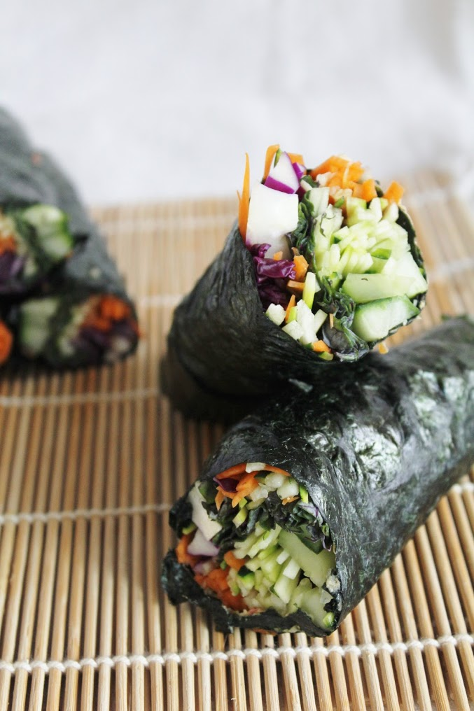 raw nori wraps with red cabbage, cucumber, carrots, zucchini & spicy dipping sauce