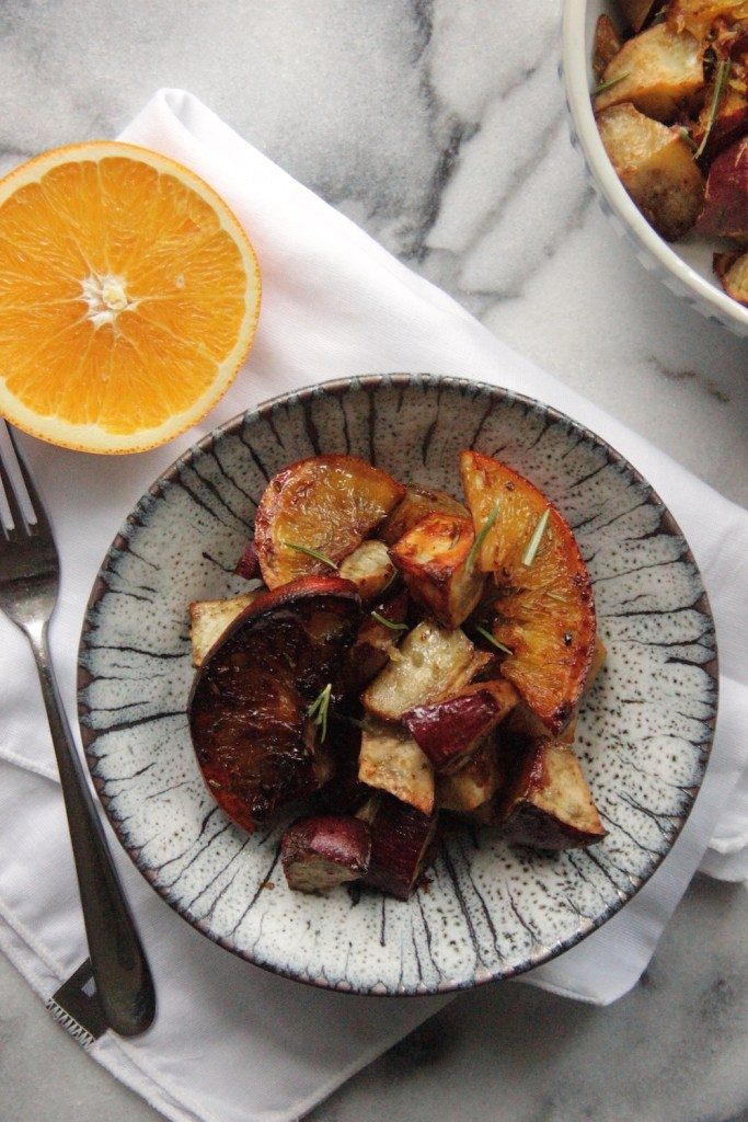 These roasted Japanese sweet potatoes are caramelized with oranges to make a delicious side or main dish for vegetarians, vegans and omnivores alike! - Recipe via A Little Rosemary and Time
