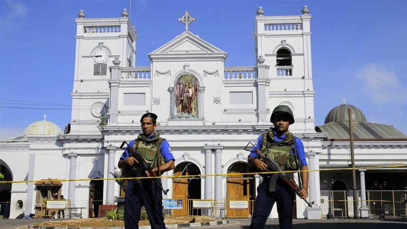 Sri Lankan soldiers stand guard in front of the St Anthony's Shrine a day after it was bombed in Colombo, Sri Lanka, April 22, 2019 [AP/Eranga Jayawardena]     [Daylife]