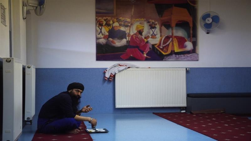 Members of the Sikh community centre in Essen, Western Germany eat on April 21, 2016 [File: Patrik Stollarz/AFP]