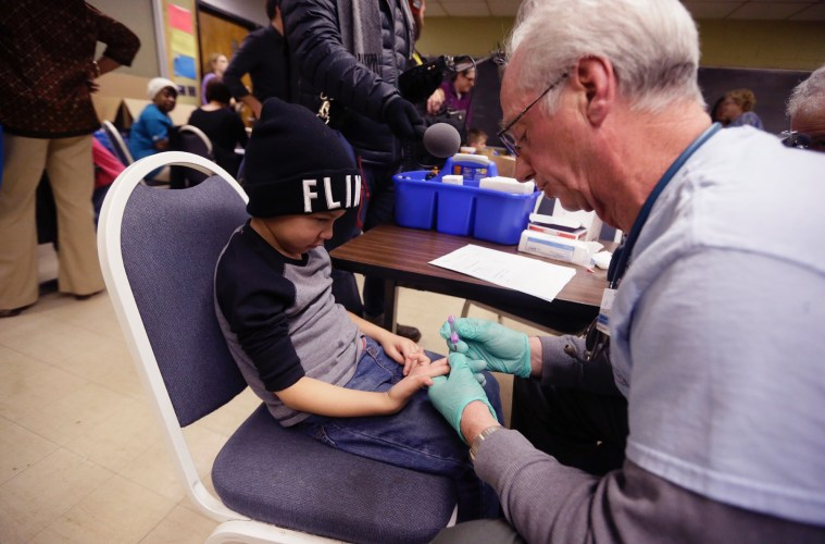 Registered Nurse Brian Jones draws a blood sample from Grayling Stefek, 5, at the Eisenhower Elementary School, Tuesday, Jan. 26, 2016 in Flint, Mich. The students were being tested for lead after the metal was found in the city's drinking water. Photo: AP / Carlos Osorio