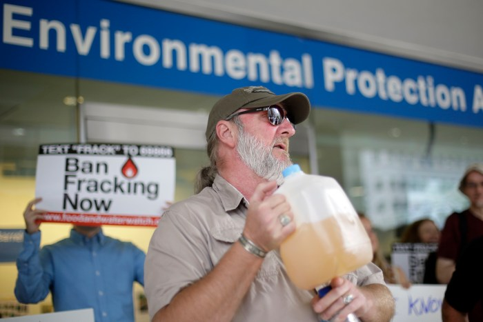 Ray Kemble of Dimock, Pa., displays a jug of what he identifies as his contaminated well water as he speaks at a demonstration opposed to hydraulic fracturing, outside a regional office of the U.S. Environmental Protection Agency, Monday, Aug. 12, 2013, in Philadelphia. The protestors plan to travel to agency's Washington headquarters to deliver petitions. (AP Photo/Matt Rourke)