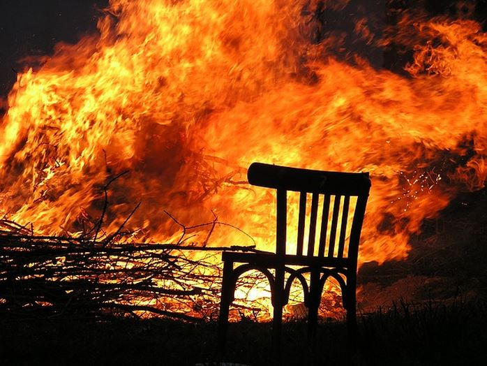 Provide writing feedback. It is critically important in fiction workshops. This picture shows a chair in a fire. Being critiqued can feel just as uncomfortable.