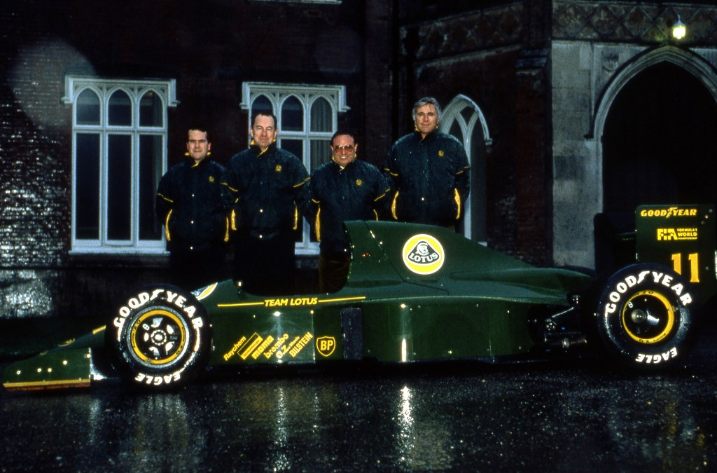 (L to R): Clive Chapman (GBR); Peter Collins (AUS) Lotus Team Manager; Horst Schubel (GER) Investor; and Peter Wright (GBR) Team Lotus Technical Director, with the Lotus 102B. Lotus Formula One Team, Ketteringham Hall, Norfolk, England, 1991.