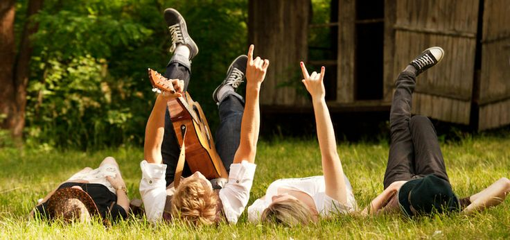 Incredible picture people laying in grass with a guitar