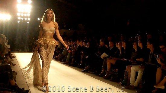 Creme-colored bra top, gold skirt, and creme harem pants