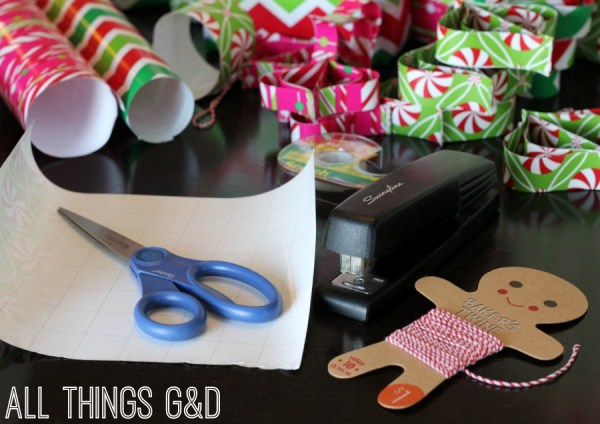 Don't throw those wrapping paper scraps away - use them to make DIY ornaments! A simple tutorial even the kids can do. | www.allthingsgd.com