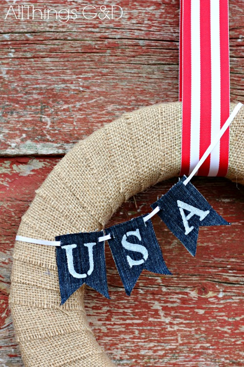 Painted denim mini-bunting on a Memorial Day wreath. | www.allthingsgd.com