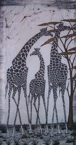 Three giraffes enjoying acacia trees. I bought this at a shop in Nairobi, Kenya.