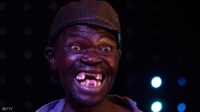 "Newly crowned ""Mr Ugly"" Zimbabwe, Maison Sere, poses during the ""Ugliest Man"" contest in Harare, Zimbabwe, on November 20, 2015. A 42-year-old unemployed man was crowned Zimbabwe's ugliest man at a pub pageant in Harare -- but the contest turned ugly when the runner-up accused judges of bias. AFP PHOTO / JEKESAI NJIKIZANA        (Photo credit should read JEKESAI NJIKIZANA/AFP/Getty Images)"