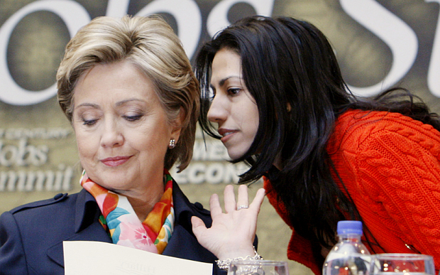 Hillary Rodham Clinton, Huma Abedin...Democratic presidential hopeful, Sen. Hillary Rodham Clinton, D-N.Y., left, has a word with aide Huma Abedin prior to the start of a discussion on jobs, Wednesday, April 2, 2008, during a campaign event at the IBEW Local Union 5 Training Facility in Pittsburgh, Pa. (AP Photo/Charles Dharapak)