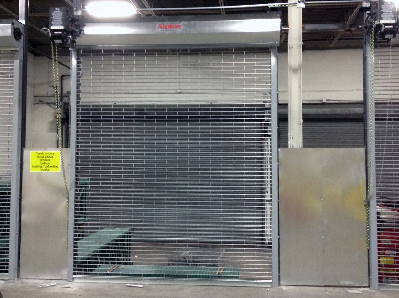 Rolling grille doors stainless grille parking garage for Roll down garage door screen