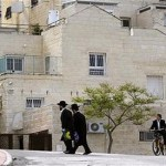 Ultra-Orthodox Jews walk through Ramat Shlomo