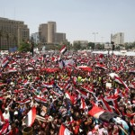 Protesters opposing Egyptian President Mohamed Mursi shout slogans against him and brotherhood members during a protest at Tahrir square in Cairo