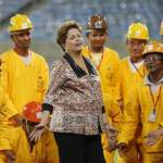 Brazil's President Rousseff talks with photographers during the opening ceremony of the Arena das Dunas stadium in Natal