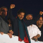 Former international cricketer Imran Khan, chairman of PTI political party, gestures to supporters during Freedom March to parliament house in Islamabad