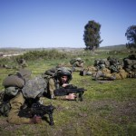 Israeli soldiers take position during an exercise in the Israeli-occupied Golan Heights, near the border with Syria