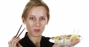 Pretty Blond Eating Sushi