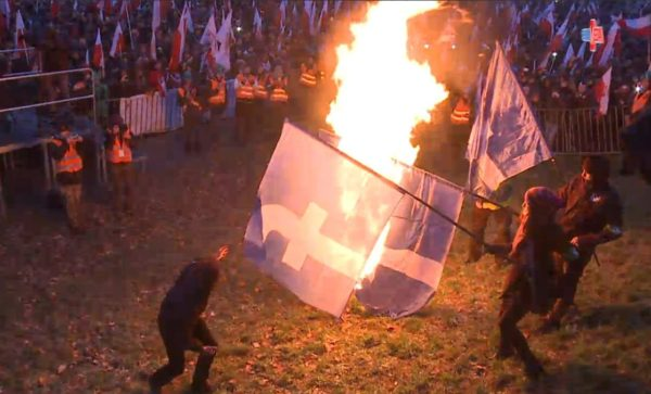 protesters_burn_facebook_flags