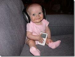 cute baby in pick, with headphones