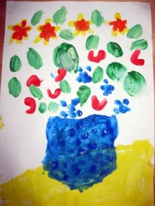 Vase with flowers, by child with finger-drawing technique