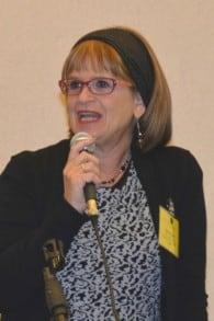 Debbie Gross holding microphone