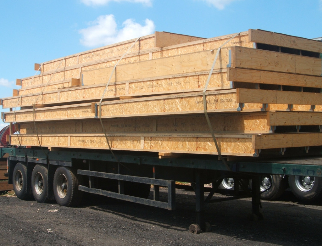 HGV flatbed trailer with wood strapped on it