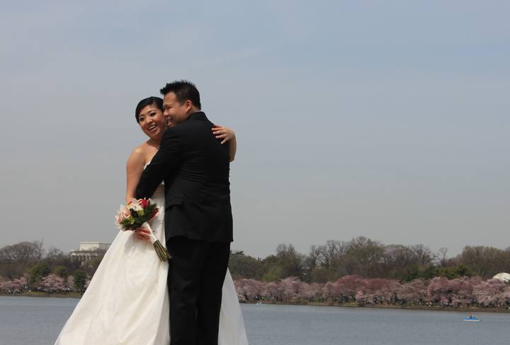 A couple poses for wedding portraits at the Tidal Basin in Washington, D.C. (Photo by Andrea Kenner, Apr. 8, 2013)