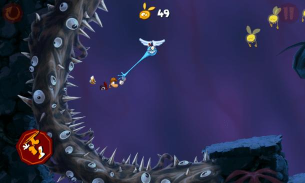 Statt an Lianen schwingt sich Rayman an blauen Flughänden über Stachelböden und Dornenranken hinweg.