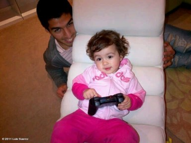 That nasty Luis Suarez with his daughter Delfi