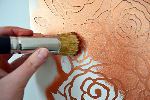 Stenciling Copper Roses Onto Wall