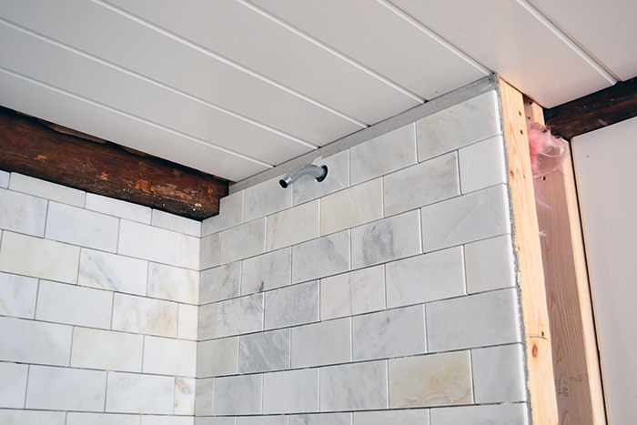Use a tile saw to make marble subway tile cuts or a diamond tipped hole saw to make round tile cuts