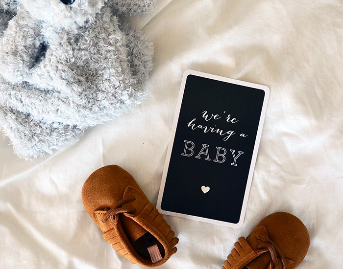 Expecting baby campbell in February 2017 with stuffed animal and baby moccasins