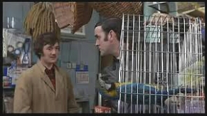 Michael Palin at left, John Cleese at right, in Monty Python's Flying Circus dead parrot sketch.