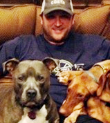 Mark Buehrle with dogs.