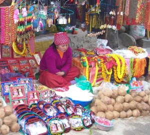 Coconut vendor at the Dakchankali Temple near Kathmandu.  Nepalese Hindus sacrifice easily 100 times more coconuts than animals,  even in temples like Dakchankali where animal sacrifice is also practiced.