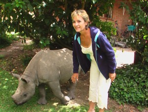 Cheryl Rodrigues and Tatenda, a baby rhino orphaned by poachers in 2007.