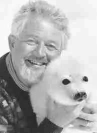 Brian Davies posing with whitecoat harp seal pup.