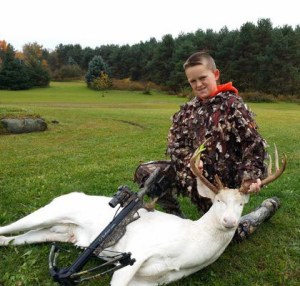 This family photo of Gavin Dingman,  11,  with the white buck he killed,  reportedly brought death threats after it was released to mass media.